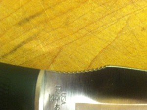 The blade's jimping aids in precise cutting.